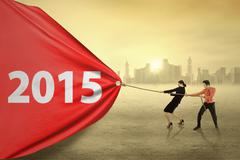 two people drag number 2015 for a change - stock illustration