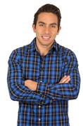 Handsome young latin man wearing a blue plaid shirt posing Stock Photos