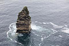 Branaunmore sea stack in Atlantic Ocean. - stock photo