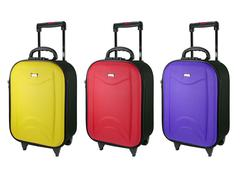 colorful travel luggage isolated on the white background. - stock photo
