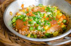 Egg with minced pork,pepper,sausage,spring onion,string bean,corn,in a frying Stock Photos