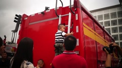 Shenzhen police open day activities, children with a fire truck, in China Stock Footage