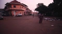 Africa street city Guine Bissau dusk Stock Footage