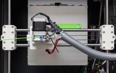 3d printer with bright green filament Stock Photos