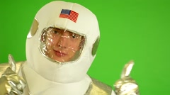 Astronaut shows thumbs on agreement - green screen - closeup Stock Footage