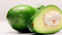 Rotating avocado fruit - stock footage
