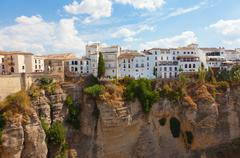 new bridge and houses on the edge of an abyss in the city rhonda, spain - stock photo