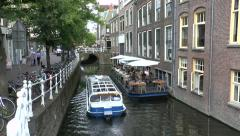 Tourist cruise boat on a canal in Delft, South Holland, Netherlands. Stock Footage