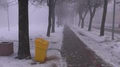 Dark heavy morning fog in snowy street Stock Footage
