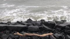 Ocean waves and black stone  coast background Stock Footage