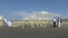 An original Strandbeest by Theo Jansen on the beach, Hague, Netherlands. Stock Footage