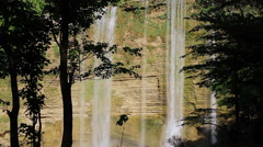 Niludhan Waterfall and beautiful trees silhouette. Stock Footage