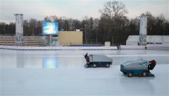 Special car polishes the ice skating rink in the city park. - stock footage