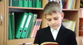 little boy reading a book at school 10 Footage