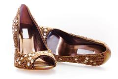 Pair of high heels with diamonds and golden beads Stock Photos