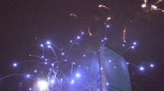 Fireworks blasting off and exploding in the sky - stock footage