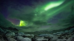Northern Lights over the frozen Arctic fjord - Svalbard - TIMELAPSE - stock footage
