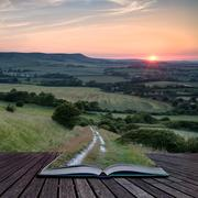 Landscape image summer sunset view over english countryside conceptual book i Stock Photos