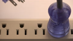 4K Man Inserts Plug Into Power Strip Stock Footage