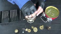Watchmaker repair old  clock Stock Footage