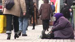 Beggar old  woman  on  street. Kiev, Ukraine, City life in winter - stock footage