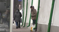 Beggar old  man  on  street. Kiev, Ukraine, City life in winter Stock Footage