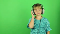 Grade school girl dancing with  retro headphones greenscreen Stock Footage