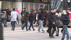 Busy streets people traffic congestion in downtown Toronto on winter day. Stock Footage