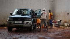 Stock Video Footage of Africa carwash company Bissau Guinea Bisseau