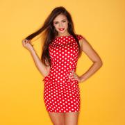 Hot woman wearing red polka dots dress with black stiletto Stock Photos