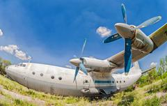old russian aircraft an-12 at an abandoned aerodrome - stock photo