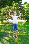 dancing girl in sunglass with sore knee - stock photo