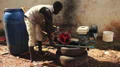 Africa mounting jetwash machine Bissau Guinea Bisseau Stock Footage