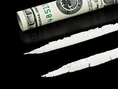 Cocaine and money Stock Photos