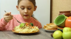 Stock Video Footage of cute kid with an appetite for eating pasta