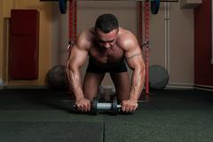 Bodybuilder Doing Abs Exercise - stock photo