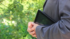 Businessman with tablet speaking Stock Footage