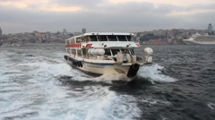 Ferry boat, regularly travel zig-zags between both sides of the shores Stock Footage
