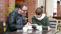 Two young,  smiling and happy people using tablet - stock footage