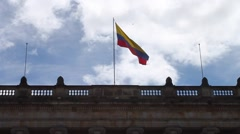 Colombian Flag Waving in Wind on Top of Congress Building Stock Footage