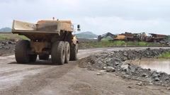 Stock Video Footage of Giant Trucks Move Dirt at Panama Canal Expansion Site