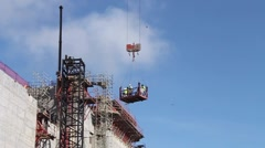 Stock Video Footage of Men Working, Lowered in Crane at Panama Canal Expansion Project