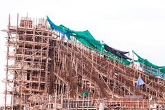 Stock Photo of structure detail in process of construction by using  alot of log
