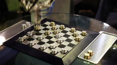 The robot is playing checkers. Stock Footage