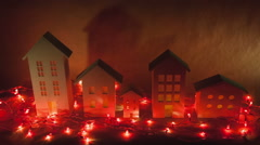 Decorative fabulous houses with red Christmas garlands create a fantastic - stock footage