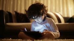 Child playing on the tablet computer games Stock Footage