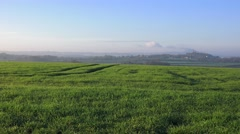Lush Countryside Rolling Green Fields Blue Skies horizon Stock Footage