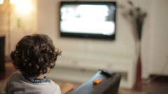 Child watching TV - dolly shot Stock Footage