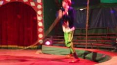 Anonymous clown jumps and having fun in the circus Stock Footage