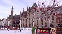 BRUGGE, BELGIUM - NOVEMBER 28 2014: Skating rink in the center of Bruges. Stock Footage